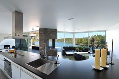 This Scandinavian villa Stockholm County, Sweden with a total living area of 238 square meters is just amazing.