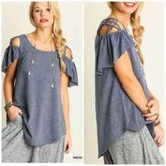 Newly Listed • Indigo caged cold shoulder top Indigo cold shoulder caged detail top with subtle high low hemline . Super soft and looks great with distressed denim , cargo pants or shorts. NWT Vivacouture Tops