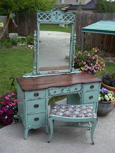 """Awesome redo of an old desk. Love the turquoise color (apparently that's the """"it"""" color right now) and the reupholstered bench. I really want a vanity like this for my bedroom."""