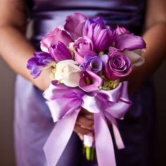 Bridesmaids. Roses, calla lilies, and tulips in shades of purple.