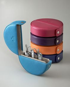 Love this!  Manicure set all tucked away in a circular leather case.  http://rstyle.me/n/dugsanyg6