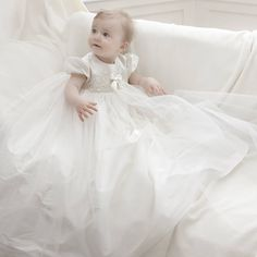 Lola is a gorgeous ivory silk dupion gown trimmed with a beautiful Venice lace and double layer tulle skirt.Available in ivory only. Your Christening gown can be personalised at the bottom of the back skirt with your baby's initials (or name) and the date of the Christening or Baptism or date of birth.The Lola gown makes a perfect heirloom Christening dress. We use only the finest laces and silks available and finish off our gowns with beautiful little handmade buttons and rouleaux loop…