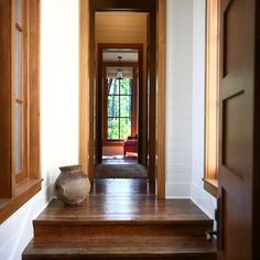 Leave door and window frames wood stain, but paint baseboards and crown molding.