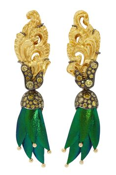 Carved Coconut Repoussé Earrings with Yellow Diamonds and Scarab A pair of elegant feminine gold repoussé carved coconut shell earrings embellished with yellow diamonds and detachable scarab tassels. Dimension: 1.6x7.5x0.6 cms.   Repoussé is a metalworking technique in which a malleable metal is ornamented or shaped by hammering from the reverse side to create a design in low relief. There are few techniques that offer such diversity of expression while still being relatively economical.