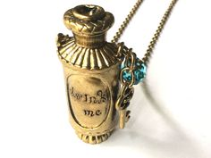 Alice in Wonderland: Drink Me Potion necklace, magic liquid bottle and key charms accented with blue crystal by VintageHomage