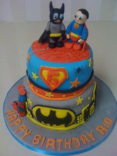 2 tier superhero cake. Batman and Superman characters.