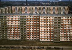 Mass housing for workers in Weissensee district (Plattenbau) with a demonstration of FDJ youth passing by, East Berlin, East Germany, 1975, photograph by Thomas Hoepker.