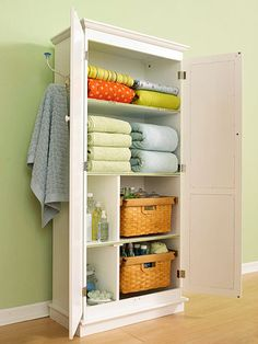 Guest room cabinet -- Hidden in plain sight.  Baskets are space-saving miracle workers when you're trying to hide clutter.  Storage items like extra bed linens, towels, potential toiletries, and magazines.