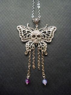 Butterfly skull necklace  Day of the dead pendant  by BleedingHD