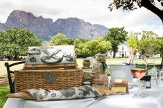 Boschendal Rhone Traditional Picnic Lunches - What's in the basket: Roast aubergine and herb pâté, smoked angelfish pâté, chicken liver parfait and onion jam, crisp loaf of country bread, seasonal salad, classic Coronation chicken, a selection of three meats, wholegrain mustard, a selection of artisan cheese and vanilla strawberry cheesecake. The vegetarian option includes a hummus pâté and a garden vegetable frittata.