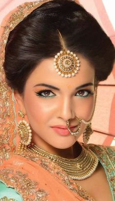 http://prettycoutures.com/wp-content/uploads/2015/01/Awesome-style-bridal-jhumka-and-nose-rings-2015-12.jpg