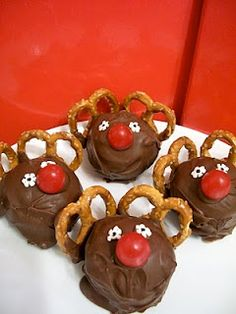 Rudolph Cake Balls: Use cake mix of your choice or a little debbie cake - Chocolate icing, small pretzel twists, round red candy or a cherry for the nose - White sprinkles for the eyes - Black food marker, or tiny crumb of chocolate morsel or dab of icing for the center of the eye. Just be creative as there are many different ingredients you could use to make this cute Rudolph.