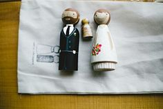 Personalized wooden figure cake topper of the bride and groom.