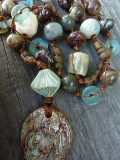 Ceramic Buddha in Aqua and Brown with Ceramic by GraceElements, $64.00.  Ah, Grace--my design soul sister!  I just want to plunge my fingers in this beautiful necklace and feel each stone and bit of fiber...
