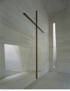 Interior view of the Holy Rosary Church by Trahan Architects. fragile cross.