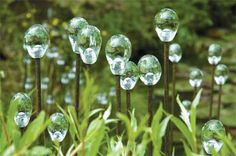 I love these glass waterdrops on rebar. garden art ideas art in gardens from hillier gardens art in the gardens 500x332