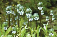 I love these glass waterdrops on rebar. garden art ideas art in gardens from hillier gardens art in the gardens 500x332