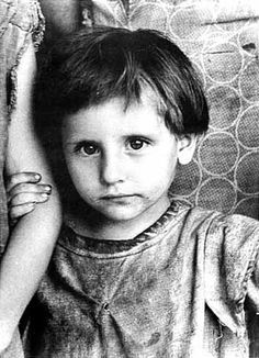Image of a child of The Great American Depression. During this time, many…