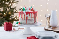 Drip cakes have been one of the hottest baking trends this year, so we thought it was time to add a big dash of Christmas to the mix! Incorporated into this Christmas drip cake is also the naked cake trend, so you're left with one showstopper of a cake that isn't all that difficult to create!