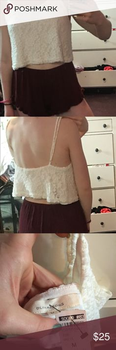 White flower patterned crop top Crop top. Extra cropped in the back. Never worn. New w tags. Smoke free house. Adjustable arm length. Skirts Mini