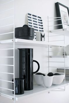 White String shelf with a black vacuum jug and a creamer by Stelton via Nordic Days. Living Room Remodel, My Living Room, Living Room Furniture, Home Furniture, Living Room Decor, Interior Styling, Interior Design, Black And White Interior, Black White