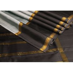 """Stripes of #grey on white body, and a #bigborder is black, makes it a """"#wow"""" saree. The thin lines of zari add a #splash to the #entirelook!"""
