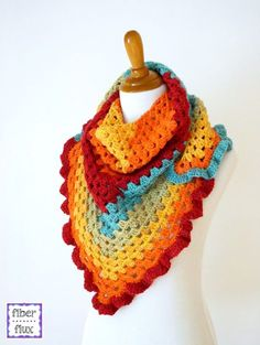 The Happy Go Lucky Shawlette is fun, colorful, and super easy to stitch up.  A simple granny triangle shows off the self striping yarn beautifully and a fabulous ruffle gives it a fun and lighthearted