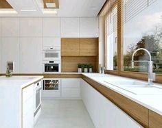 Creativo diseño de #cocina con gavetas y puertas separadas del tope por detalle en calido tono de madera Ve mas #ideas para #remodelar en: arquitecturacreativa.blogspot.com Siguenos también...