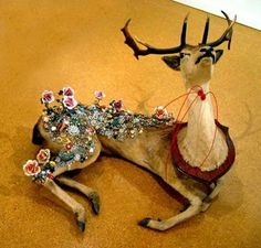 Crazy Taxidermy, but love the idea of the flowers growing.