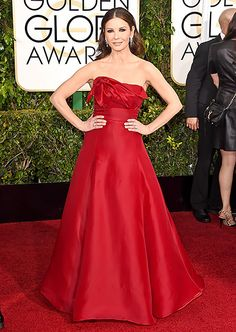 Catherine Zeta-Jones The Welsh stunner wore a strapless, blood-red dress with a structured bodice and full ski