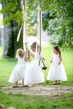 Because of this photo, my mom might win... flower girls on the Cedarwood swing are just too cute.  www.cedarwoodweddings.com. Photo by Mary Rosenbaum.