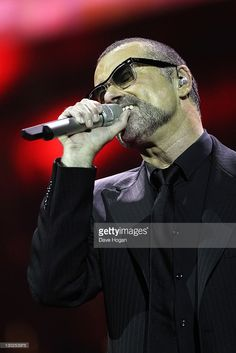 George Michael performs onstage for his Symphonica: The Orchestral Tour at The Royal Albert Hall on October 25, 2011 in London, United Kingdom.