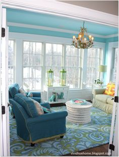 Sunroom: turquoise ceiling, kelly green accents, chandelier.  Love it, and would enjoy this room very much.