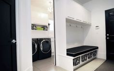 Laundry room by Atmosphere ID. Love the way it is separated into a laundry section and a mudroom section - great idea for laundry rooms with wasted space.