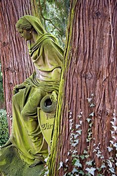 The green lady between the trees © All Rights Reserved Taken on: March 28, 2009 Frau zwischen den Bäumen  This figure from the alter Friedhof in Darmstadt always looks like she's just stepping out from between the trees. I've often tried to get this shot, but this time the light was just right - an advantage of being local. And no, I haven't messed up on the colours, these are as close to real as I could get.