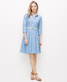 """Clean,+crisp+and+confident,+our+iconic+shirtdress+rules+the+day+with+refined+stripes+and+a+prettily+pleated+skirt.+Add+strappy+sandals+and+a+slim+leather+belt+for+a+pop+of+polish.+Point+collar.+3/4+sleeves+with+button+closure.+Button+front+placket.+21""""+from+natural+waist."""