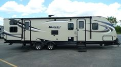 """FAMILY FUN ON THE GO!!! 2017 Keystone Bullet 308BHS You'll have no problem towing this 6248 lbs, 35' 6"""" long RV! With improved axel equalization and impact absorption, you can handle almost any terrain. In the kitchen you'll find full extension drawers with ball bearing glides for smooth sliding. The outside shower helps get rid of extra dirt after outdoor activities! Give our Bullet expert Gabrielle Selvius a call (616) 890-3879 or send an email to gabs@natlrv.com for pricing."""