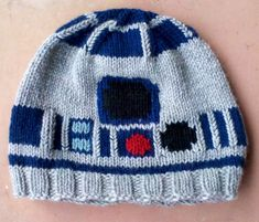 R2-D2! My absolute favourite Star Wars knitting project. Done a few with variations.