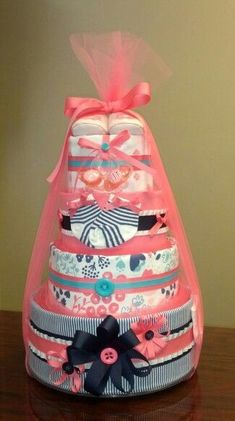 Diaper Cakes are the best gift for a Baby Shower and so easy to make