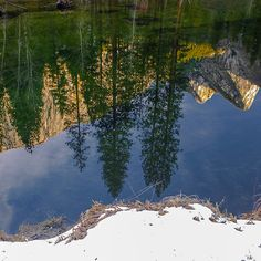 Three Brothers Reflected in the Merced River