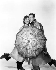Gene Kelly (Singin' in the Rain),With Debbie Reynolds. So cute! The reason why I bought my yellow rain boats. :)