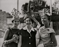 Three women in novelty hats attending the Atomic Age Exhibition in Brussels, April 17, 1958.