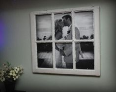 A large photo in a old window pane