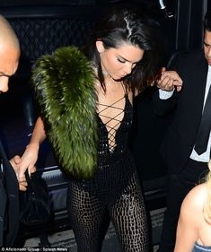 Birthday girl: Earlier, Kendall wore a flesh-baring outfit with a lace corset top that flashed some cleavage as part of a semi-sheer jumpsuit