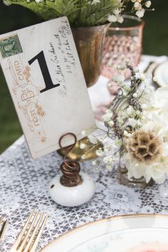 postcard table numbers and doorknob holders for postcards or menues