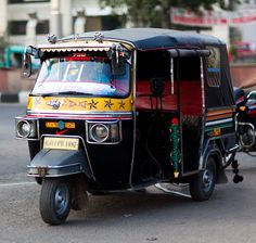 Indian rickshaw taxi. When I was in India, I loved seeing the buses, trucks and rickshaws decorated in unique and fabulous ways.