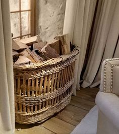 An old French baguette basket is used in a window recess, out of the way, for firewood Firewood Rack, Firewood Storage, Firewood Basket, French Country Cottage, French Country Style, Rattan, Basket Weaving, Wicker Baskets, Decoration