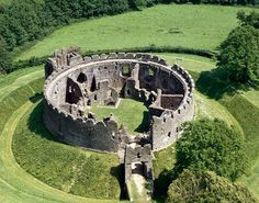 Restormel Castle (Cornish: Kastel Rostorrmel) near Lostwithiel in Cornwall, England....     http://www.castlesandmanorhouses.com/photos.htm   ...     Located on high land overlooking the River Fowey, Restormel Castle is an unusual, perfectly circular, shell keep with an internal 13th century bailey. It contains  domestic buildings, clustered around the inside of the wall to form a defensive bailey: a kitchen, hall, solar, guest chambers and an ante-chapel.: