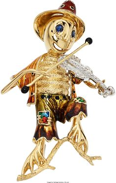 The whimsical 18k gold brooch depicts a cricket playing a diamond set fiddle, accented by round-cut sapphires and applied polychrome enamel. Total diamond weight is approximately 0.20 carat. Gross weight 49.00 grams. Dimensions: 3-1/4 inches x 1-1/2 inches Estimate: $2,000 - $3,000.