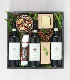 A special trio of Mauro Molino wines displayed alongside artisinal treats: 'Sommelier's Choice' by Winston Flowers.